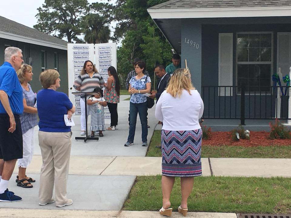 people gathered at habitat for humanity event